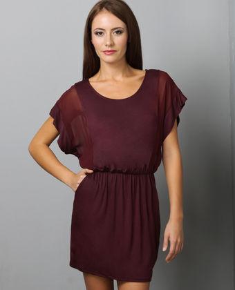 music video burgundy dress
