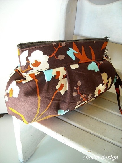 charm design orchid in chocolate zipper pouch