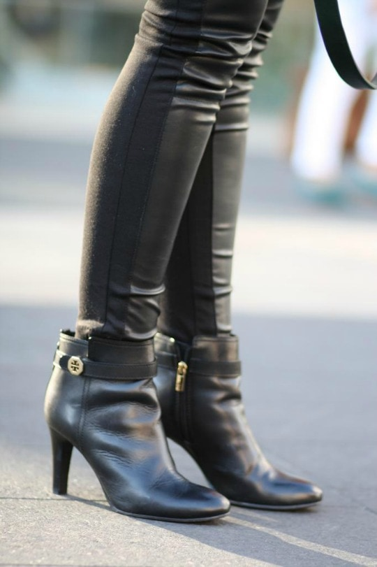 feather necklace, booties, leather leggings, statement bag