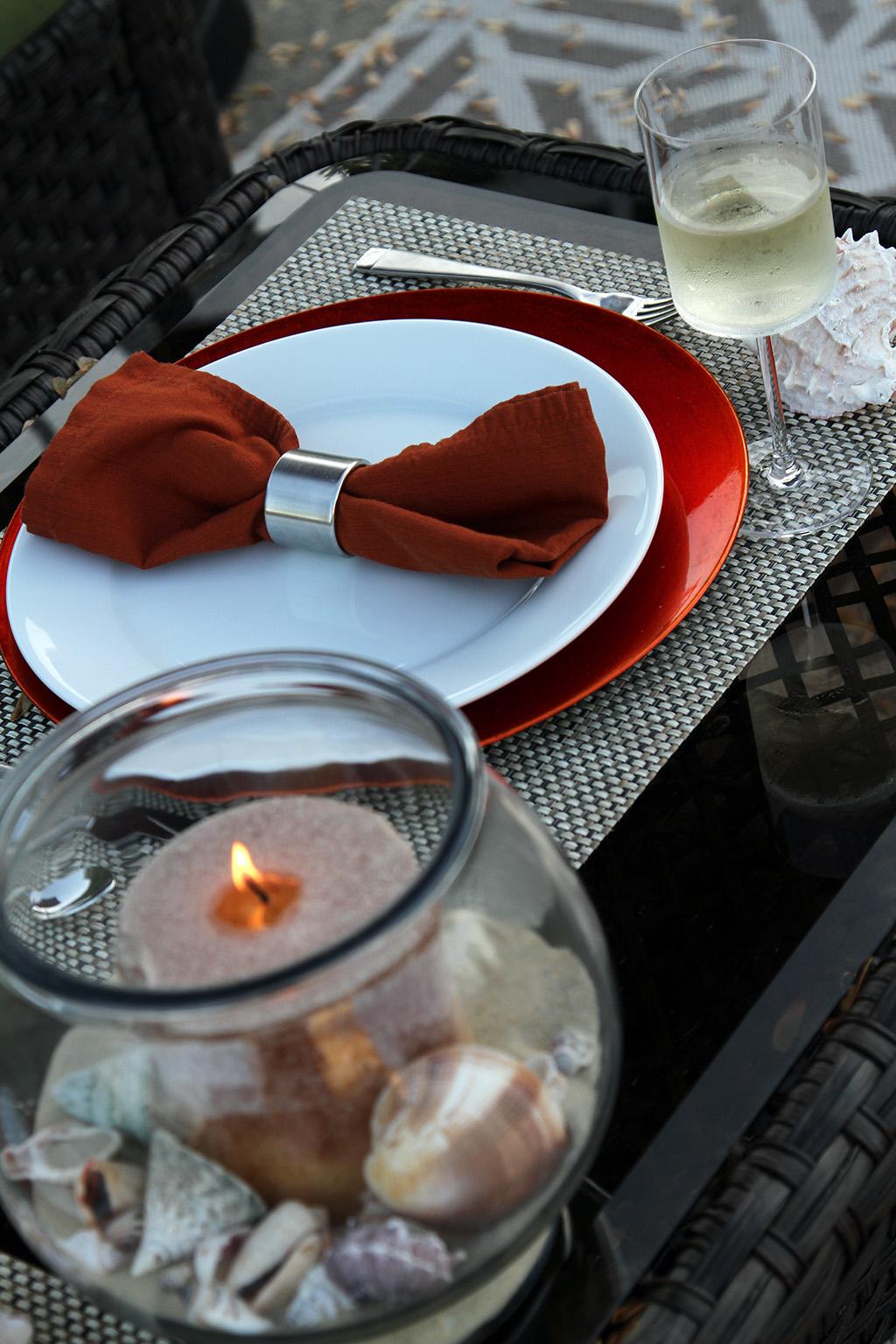 Table Setting with Orange Napkins
