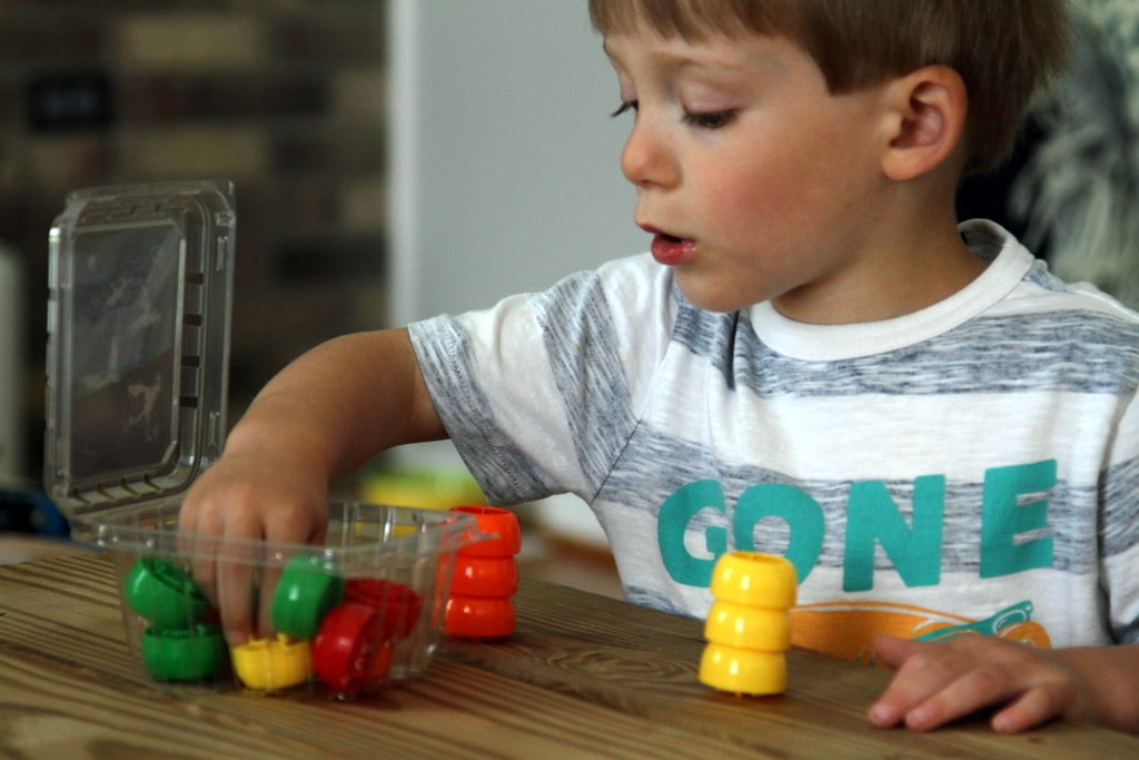How to Play with Squeeze Pouch Caps - Games for Kids to Play - Stacking Game with red, yellow and green squeeze pouch caps