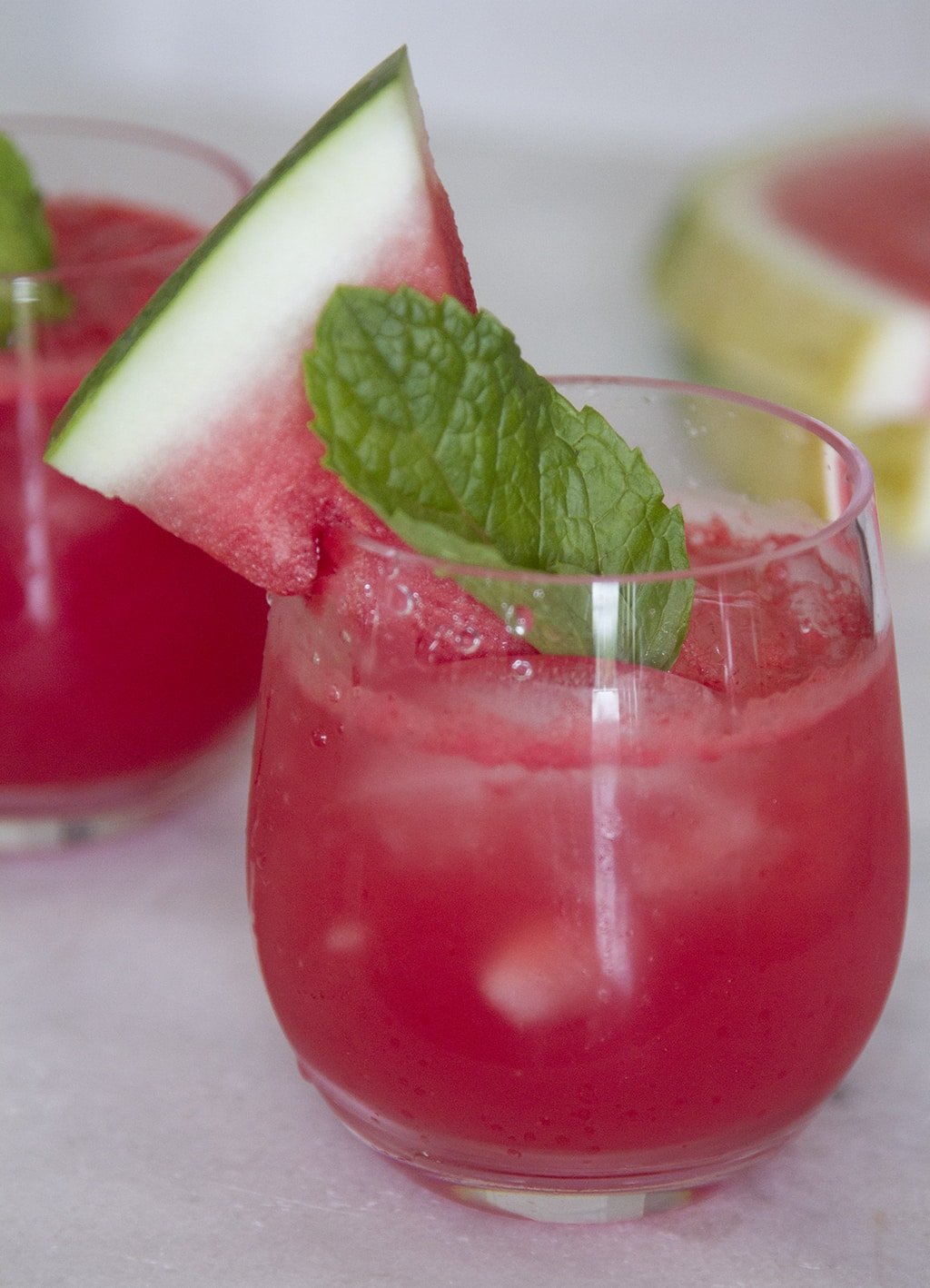 Watermelon Vodka Cocktail in a glass garnished with mint and a watermelon slice