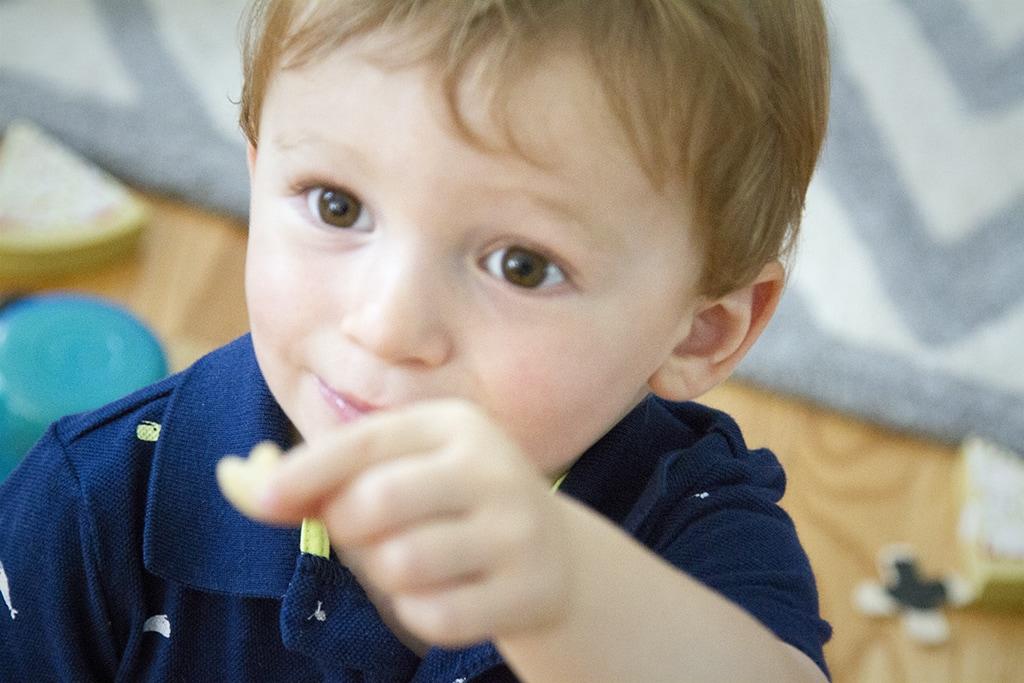 Max loving the Aldi Little Journey puffs