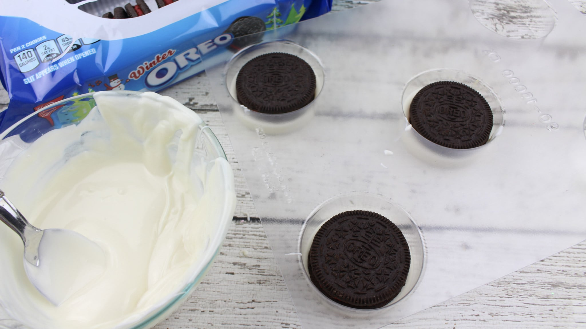 Moana Inspired White Chocolate Oreos - Quick and Sweet Party Treat. Moana treat process - Oreo cookies in cookie molds with melted white chocolate.
