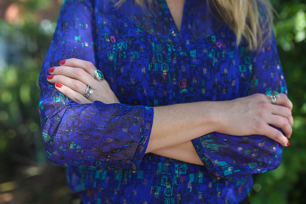 What to Wear To A Holiday Lunch - blue blouse and turquoise rings