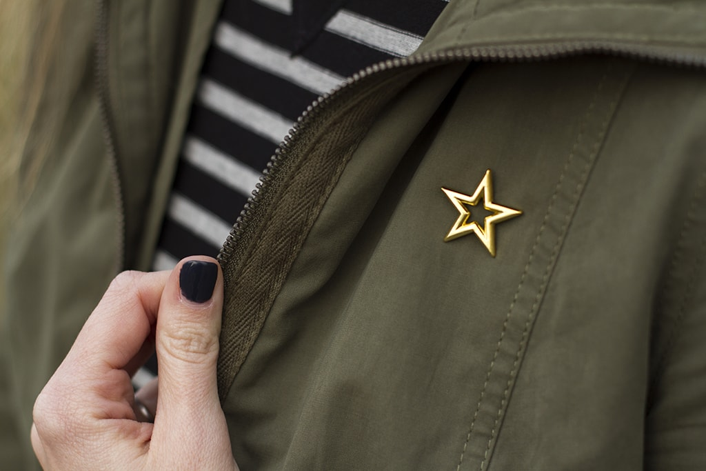 Star Pin on Green Jacket