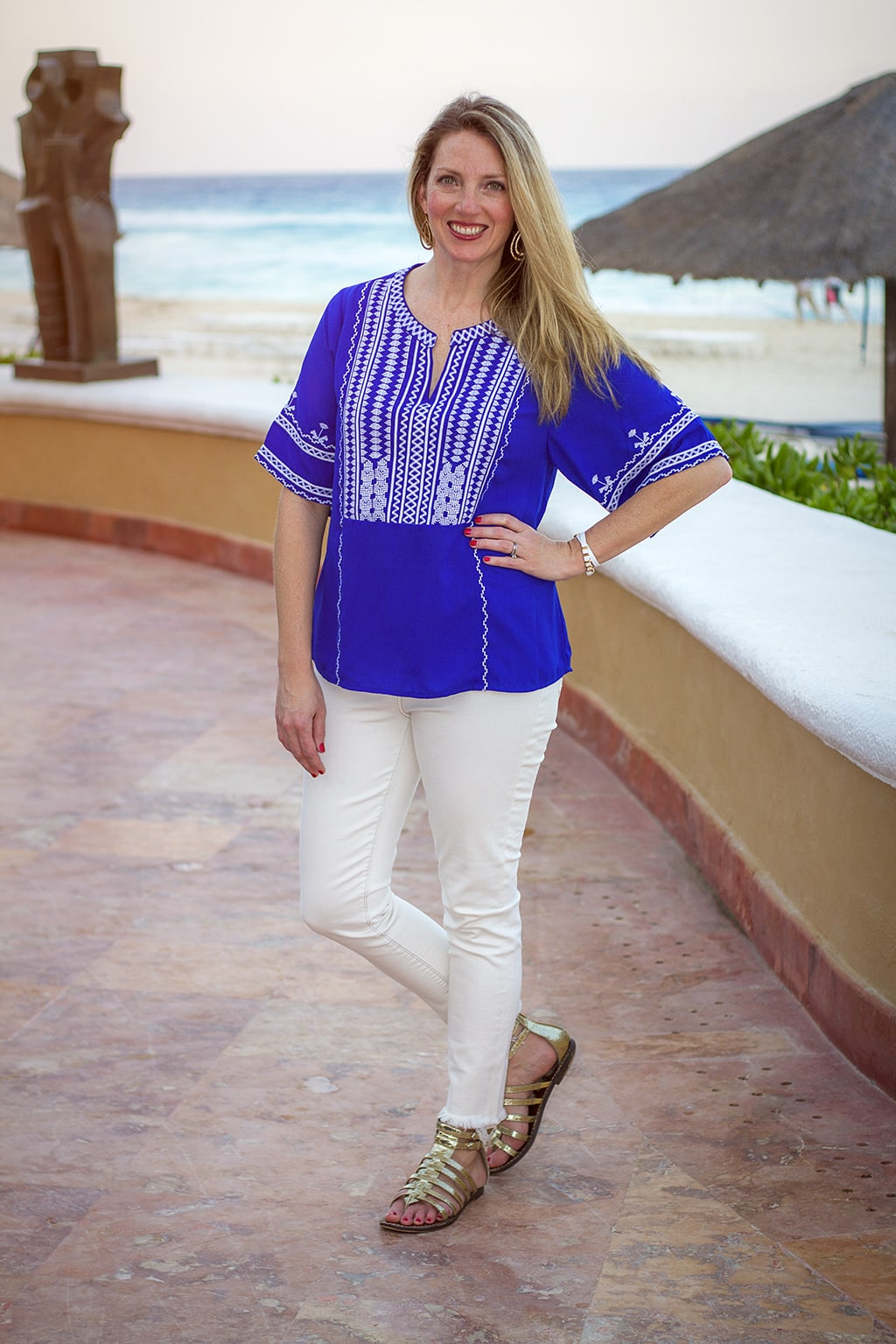 White frayed jeans and blouse