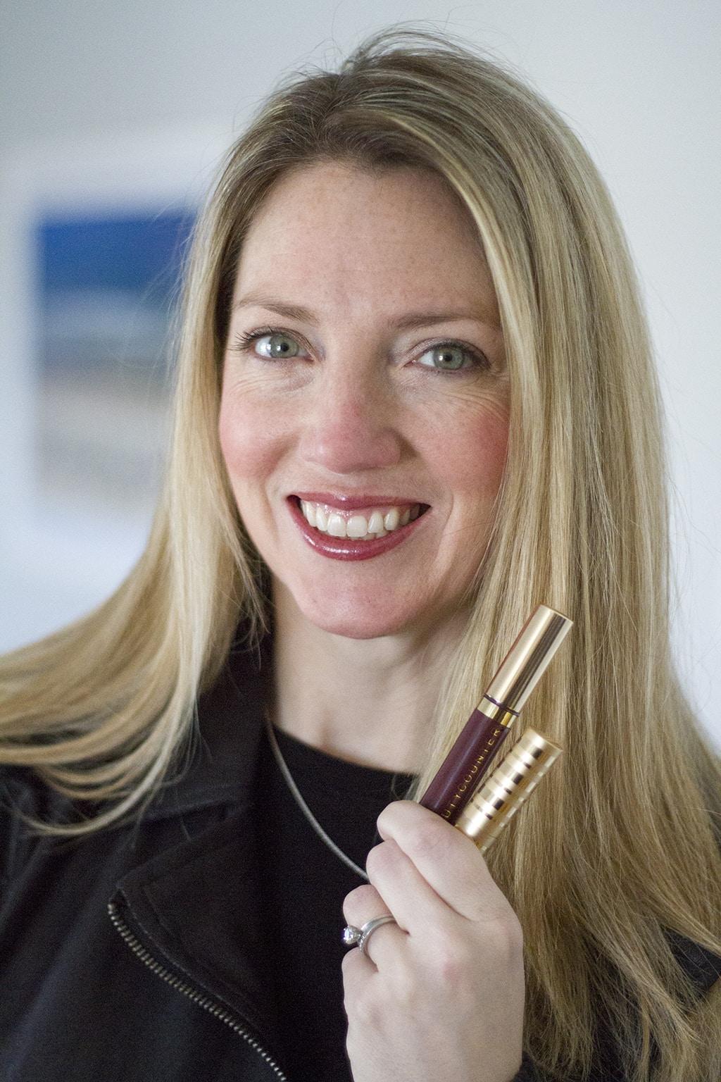 woman holding beautcounter makeup