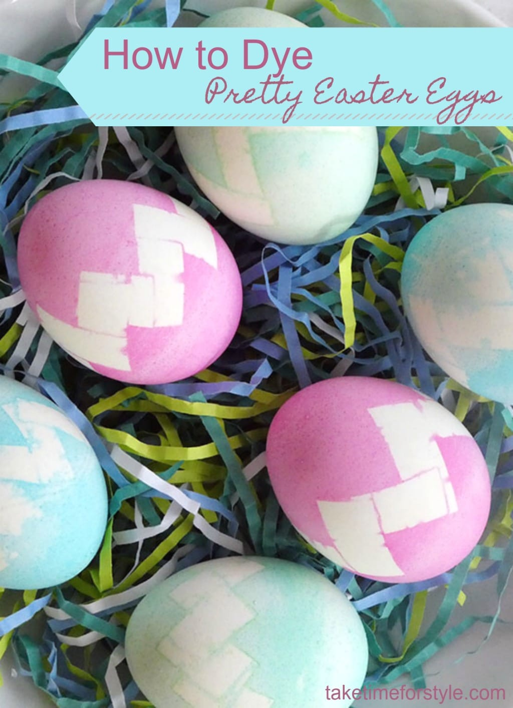 pretty Easter eggs on multi colored paper grass