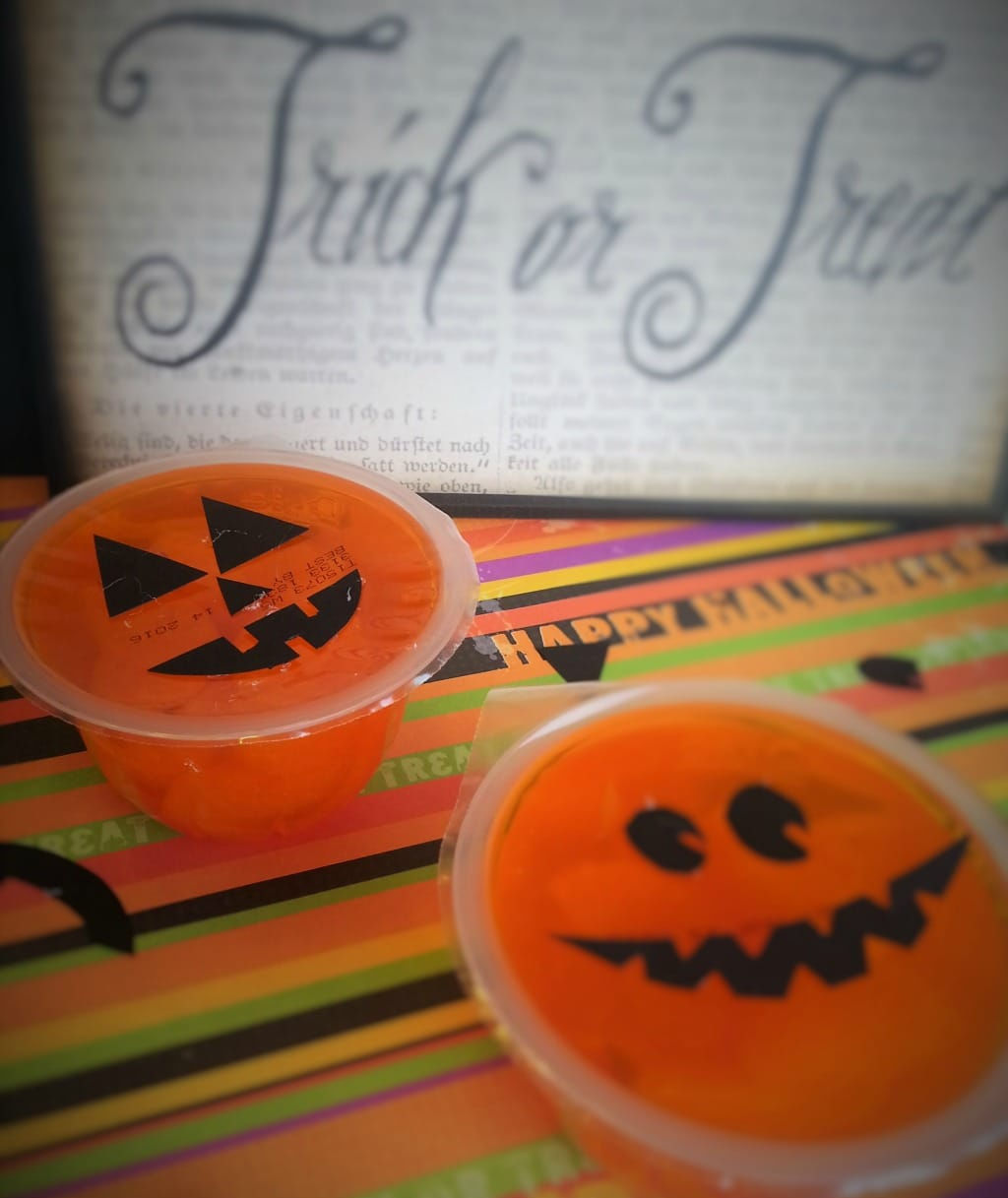 fruit cups decorated as jackolanterns