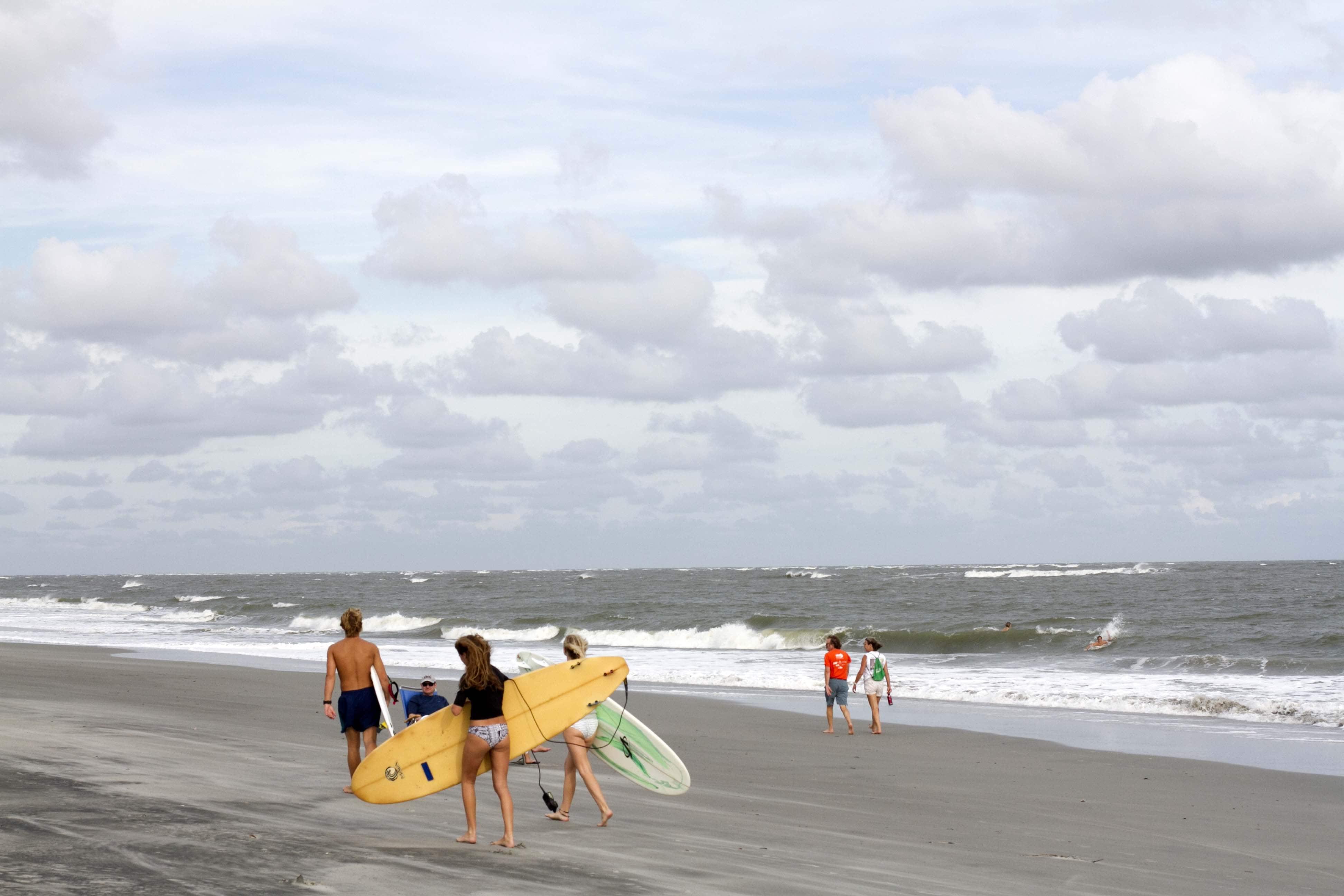 Surfers at Wild Dunes Resort