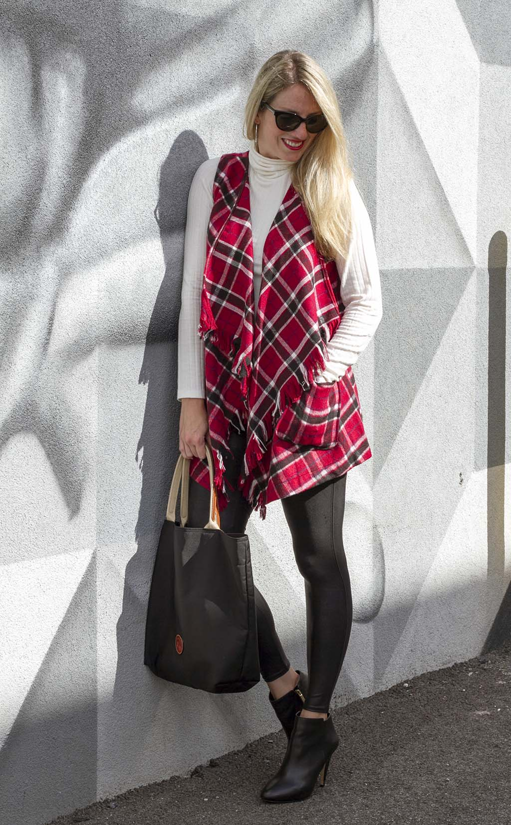 Leaning in a Fringed Plaid Vest