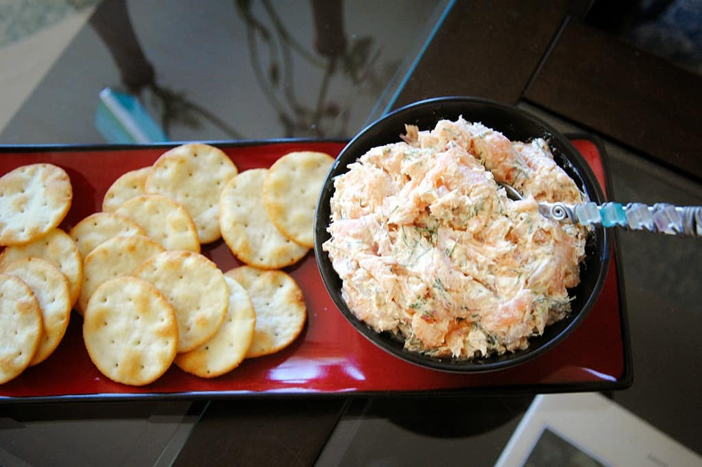smoked salmon dip on a tray with crackers
