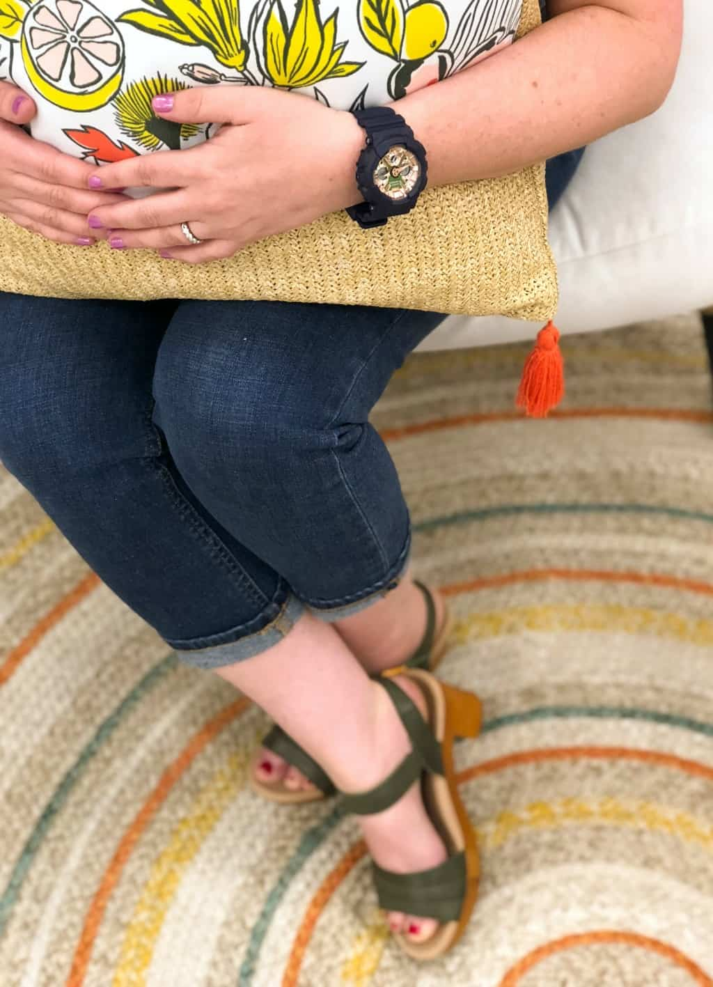 platform sandals, a multi colored rug and a throw pillow that are perfect for spring