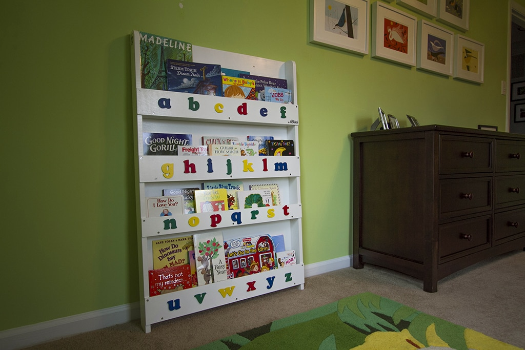 Bright green toddler room with bookshelf