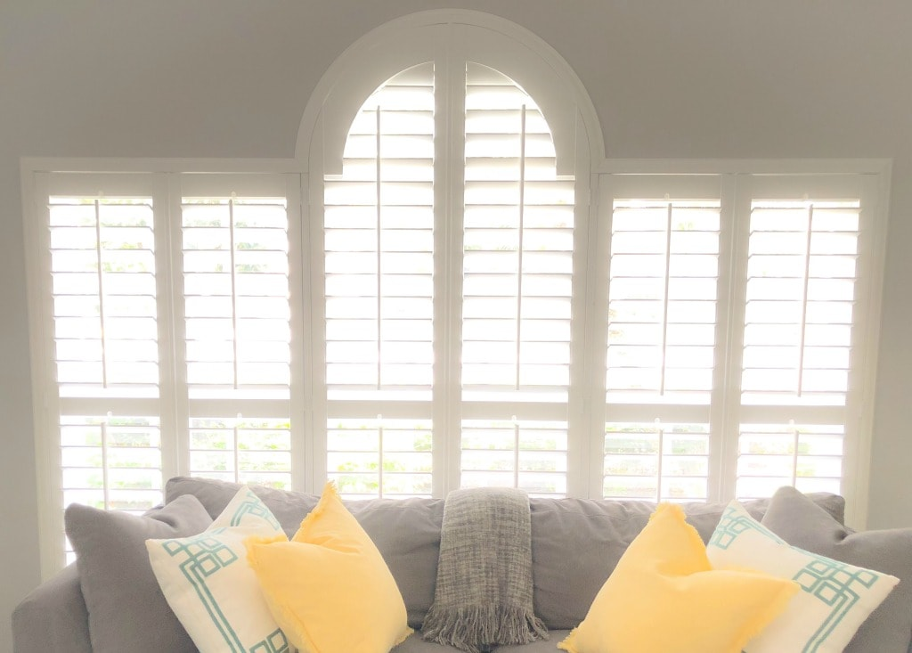 custom plantation shutters with arch