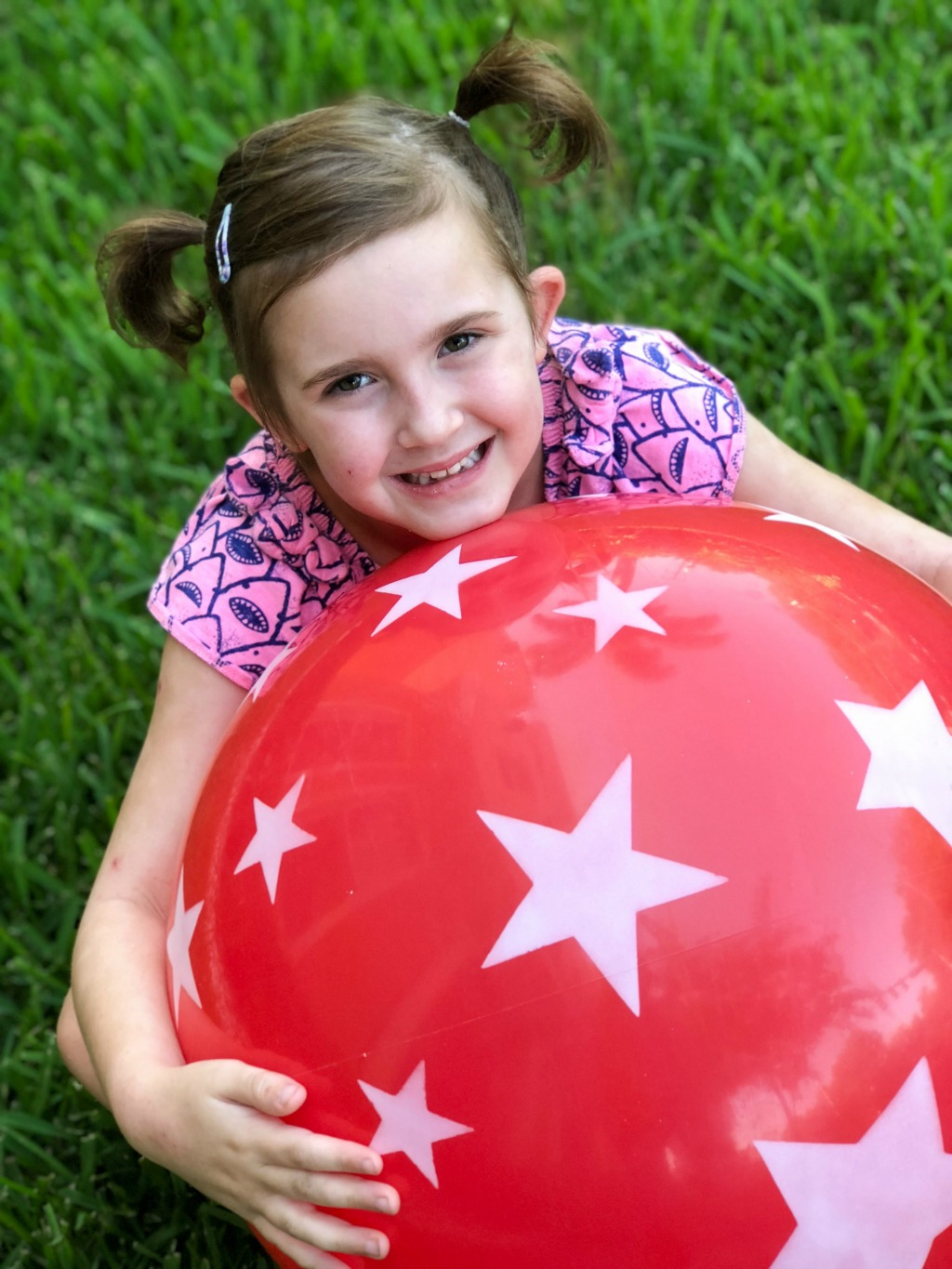 girl playing with giant bouncy ball
