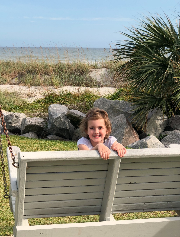 little girl on beach swing at myrtle beach