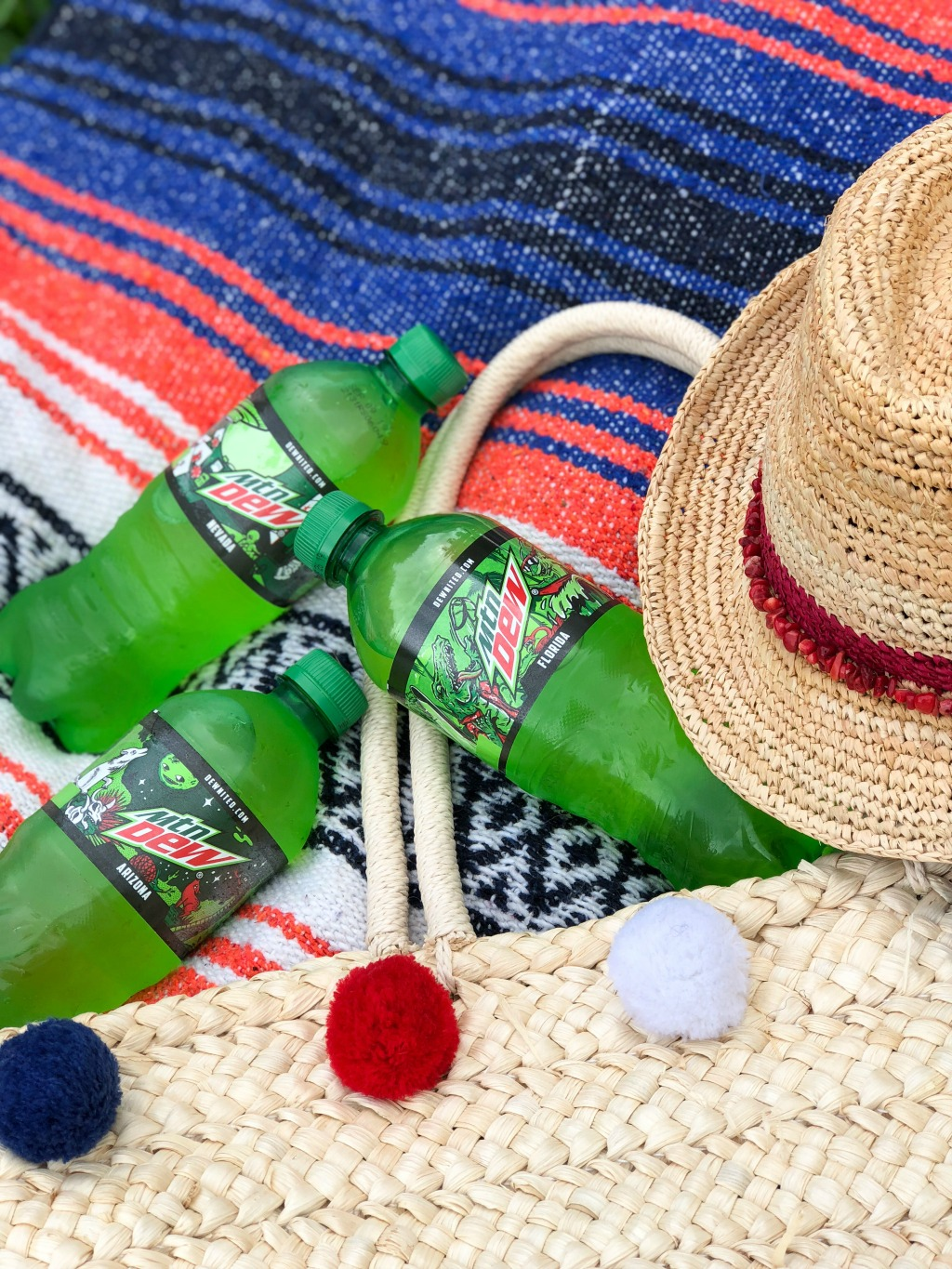 mountain dew bottles on beach blanket