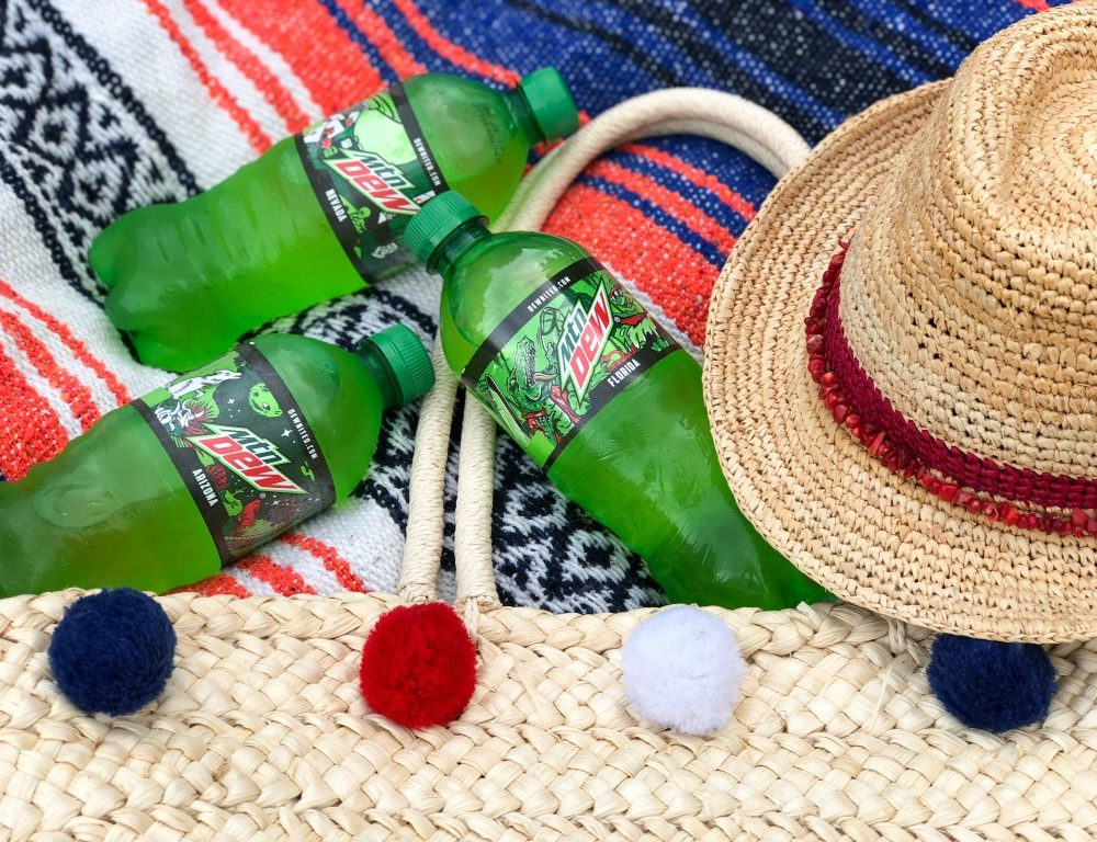 mountain dew state bottles on beach blanket