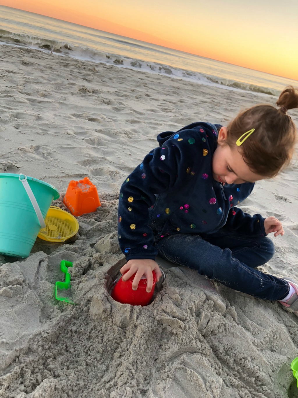 little girl building sand castles with myrtle beach sand
