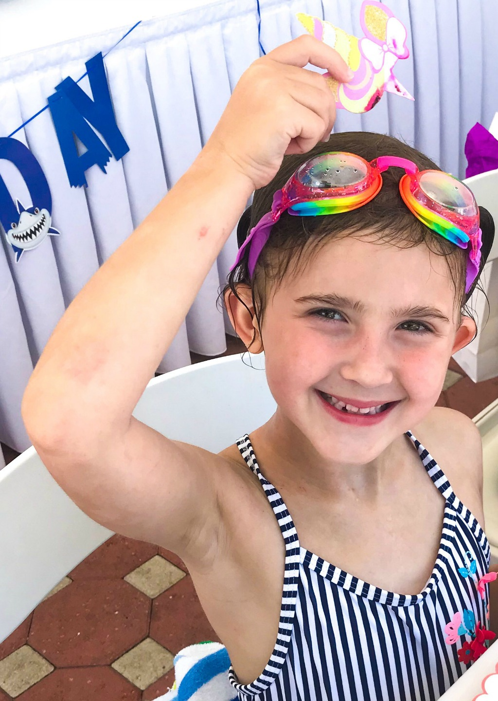 little girl at pool birthday party