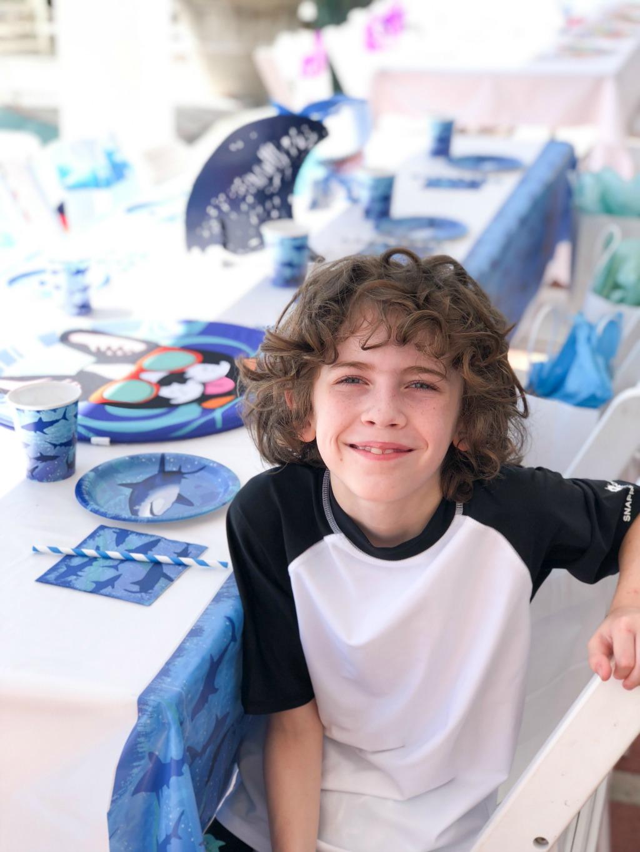 tween boy at shark birthday party