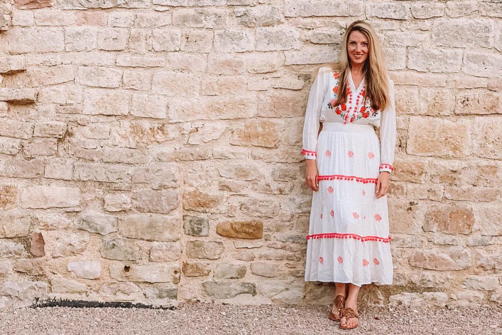 White maxi dress against wall