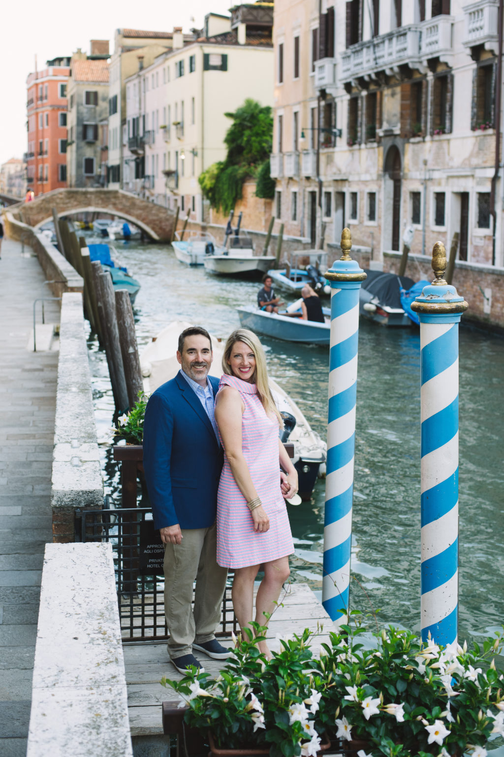 Couple on canal in Venice, Italy