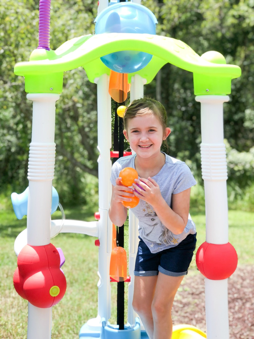 girl playing with little tykes tumblin tower