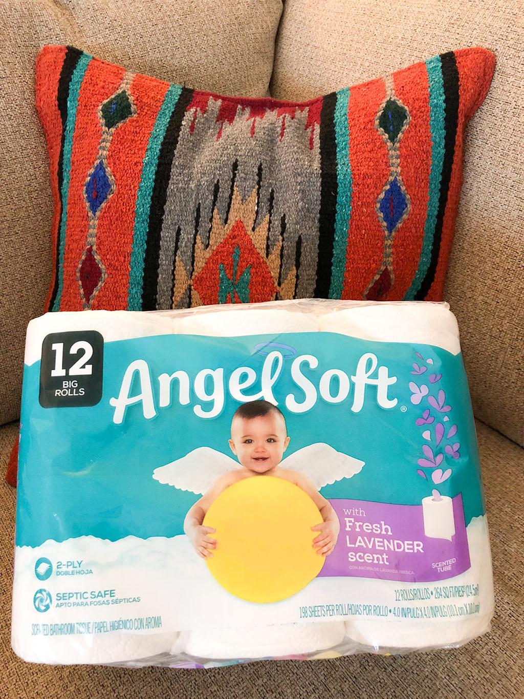 package of angel soft toilet paper on a couch