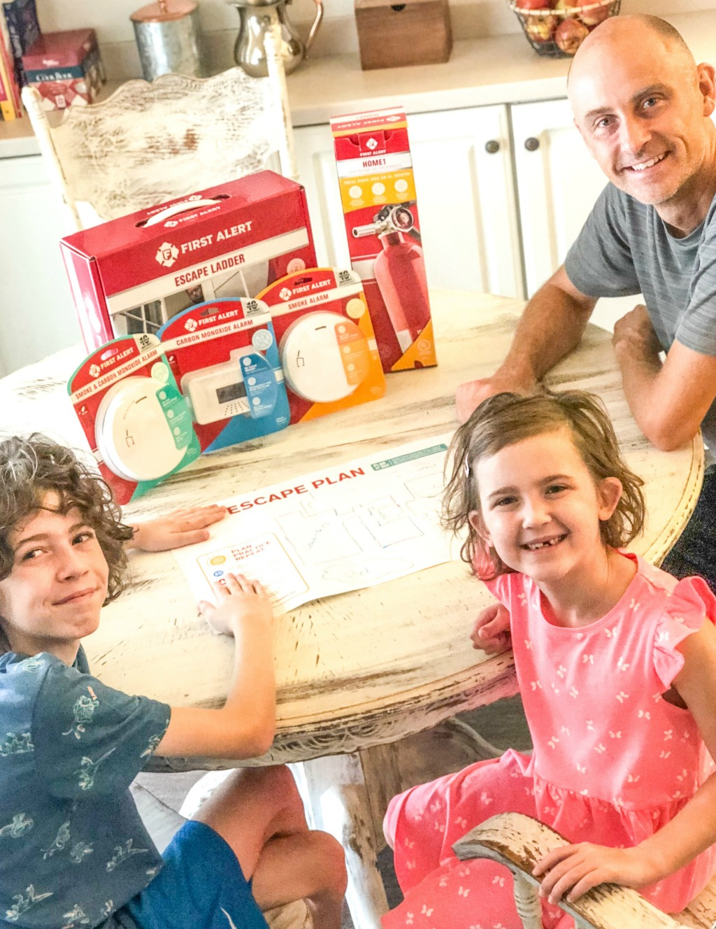 family going over emergency escape plan at table