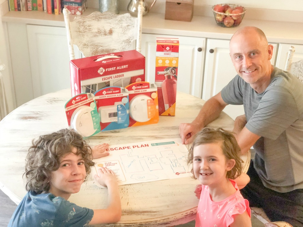 first alert safety products on table with family