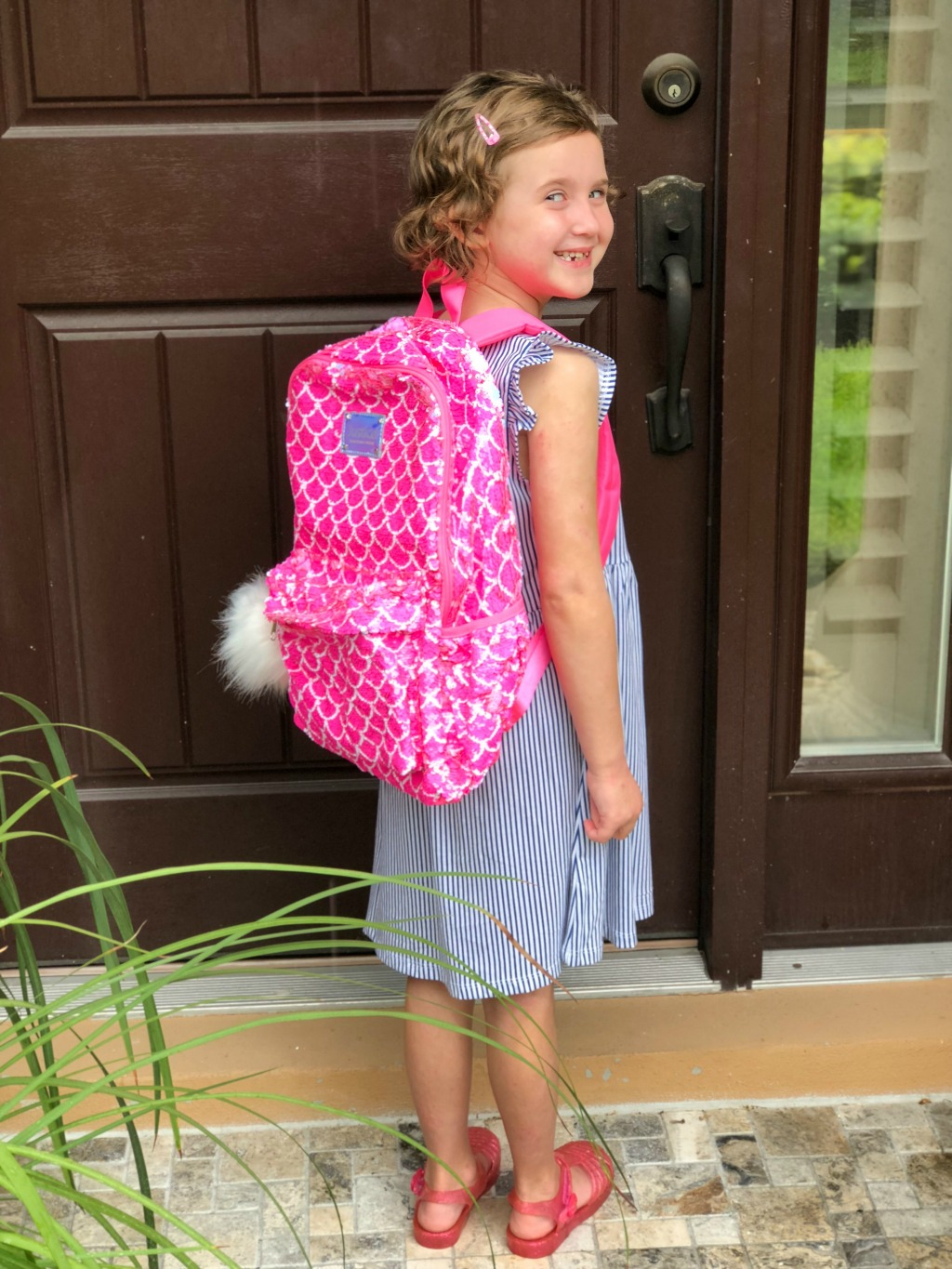little girl wearing flip sequin backpack