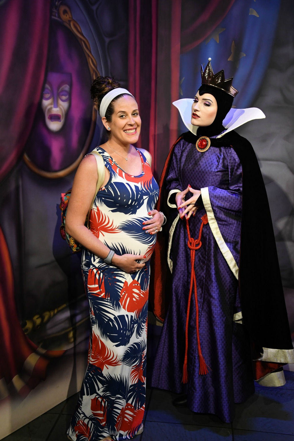pregnant mom with Snow White's evil queen