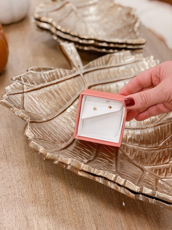 small pyramid stud earrings in metal leaf dish