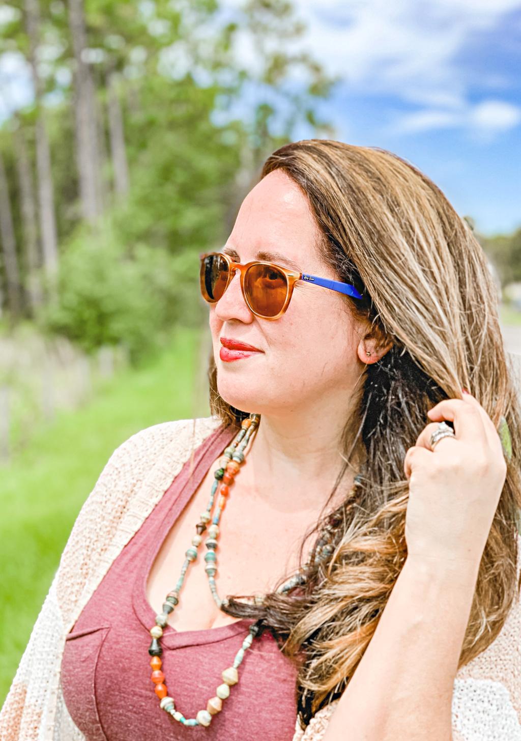 woman wearing small stud earrings