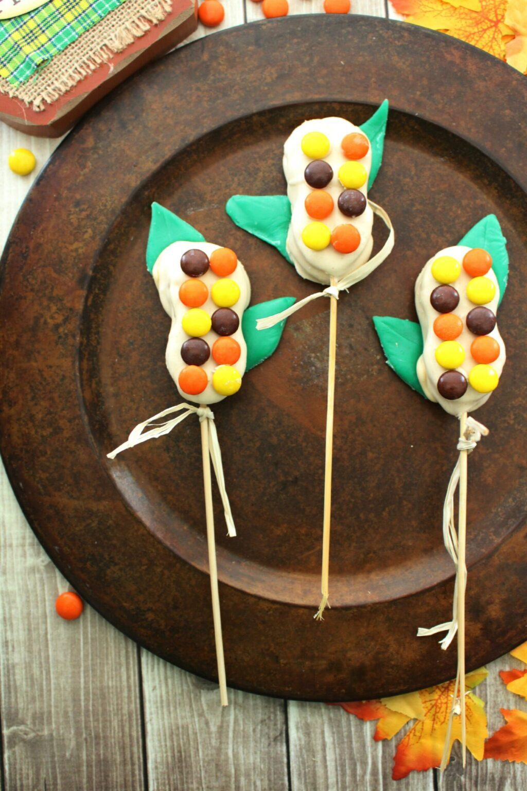 candy corn treats on brown plate