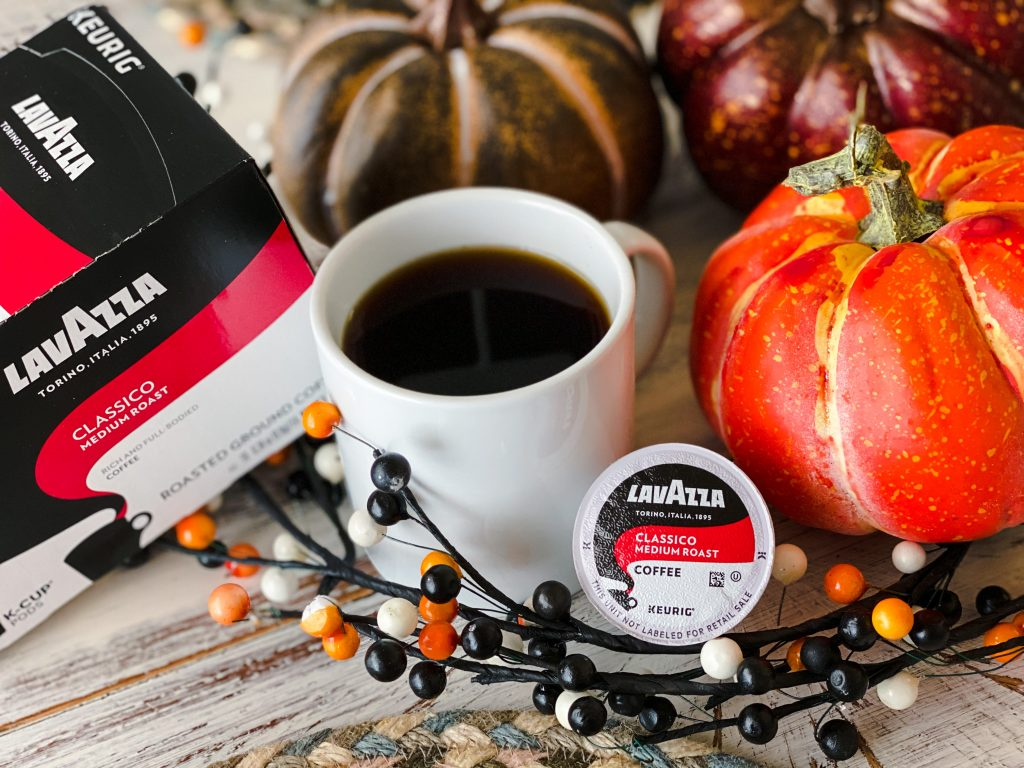 black coffee in white mug with Lavazza K-cup and fall pumpkins