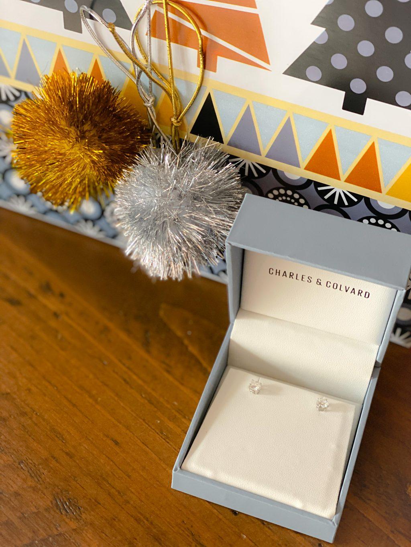 stud earrings in gray box