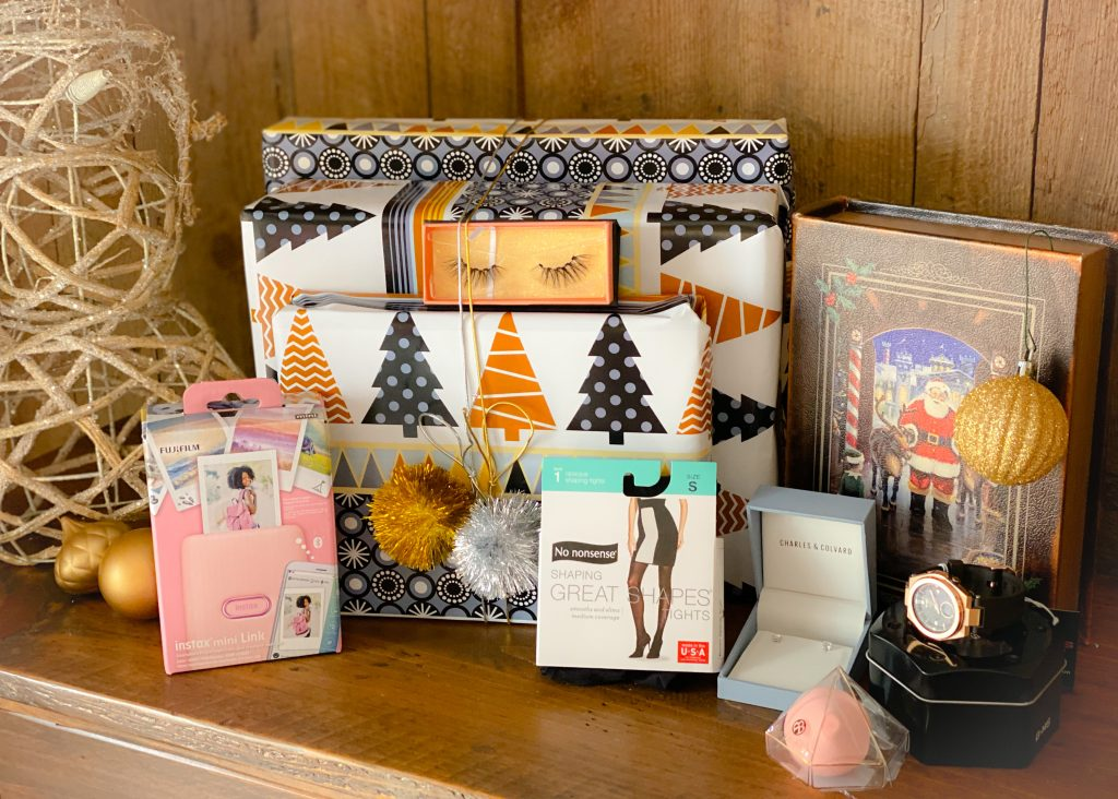 stocking stuffers for her on wooden console table
