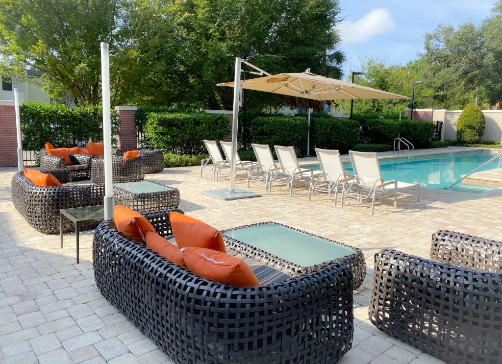 florida pool with brown wicker patio furniture