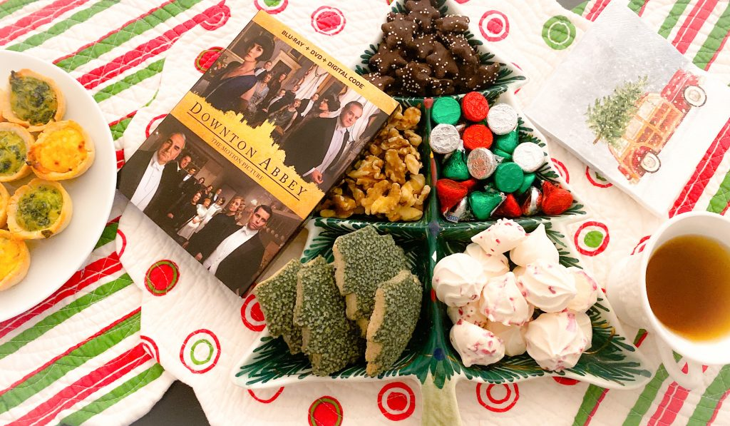 chocolate candies, cookies and nuts in christmas tree tray