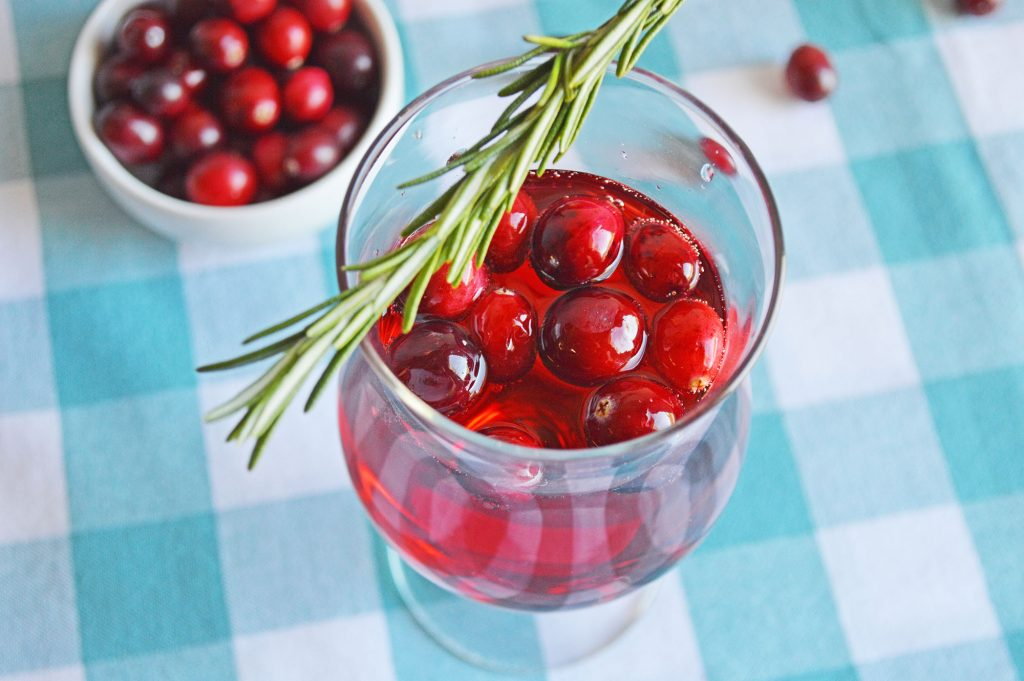 cranberry mimosa drink on checked tablecloth
