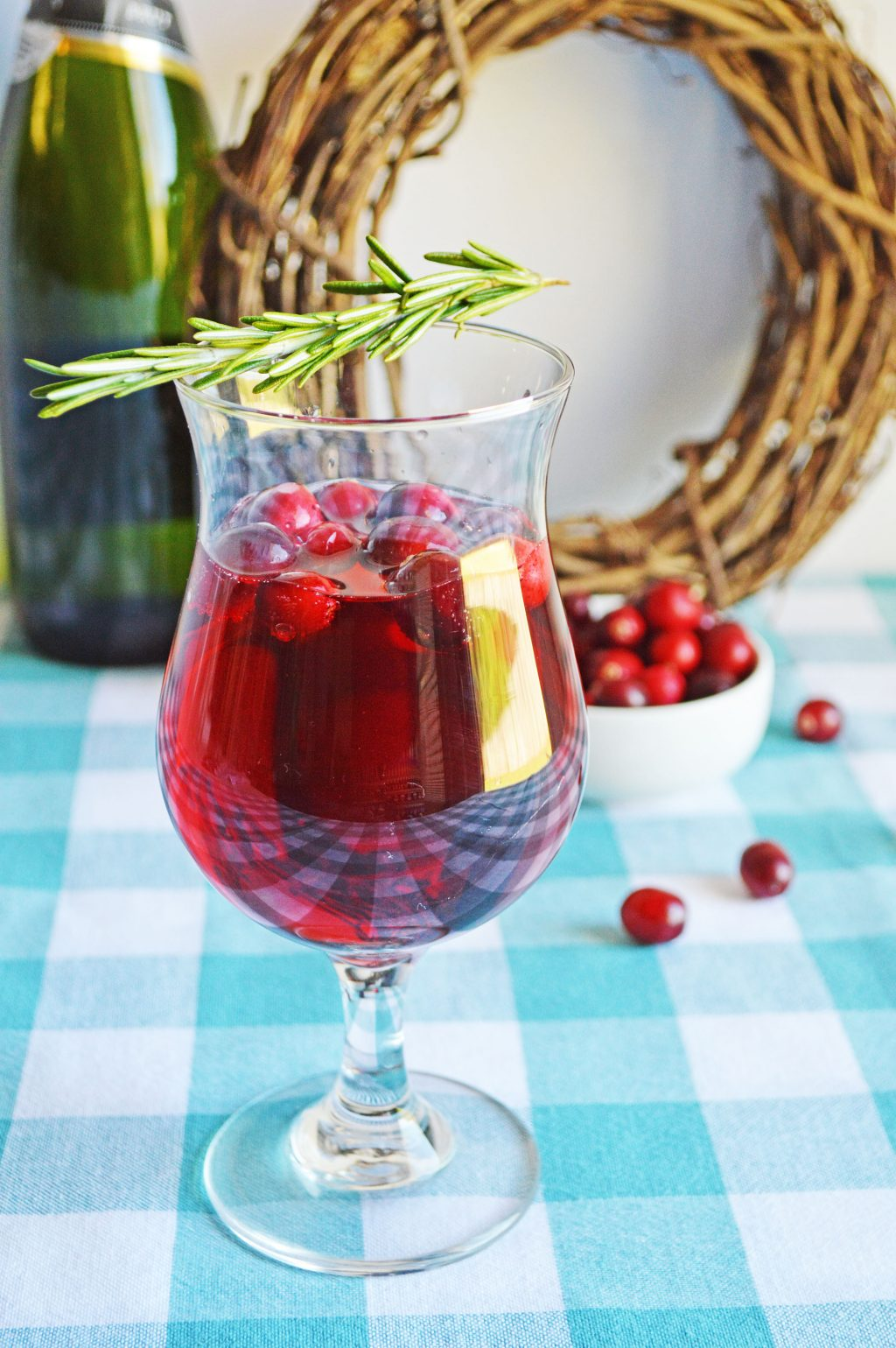 cranberry mimosa on aqua and white checked tablecloth