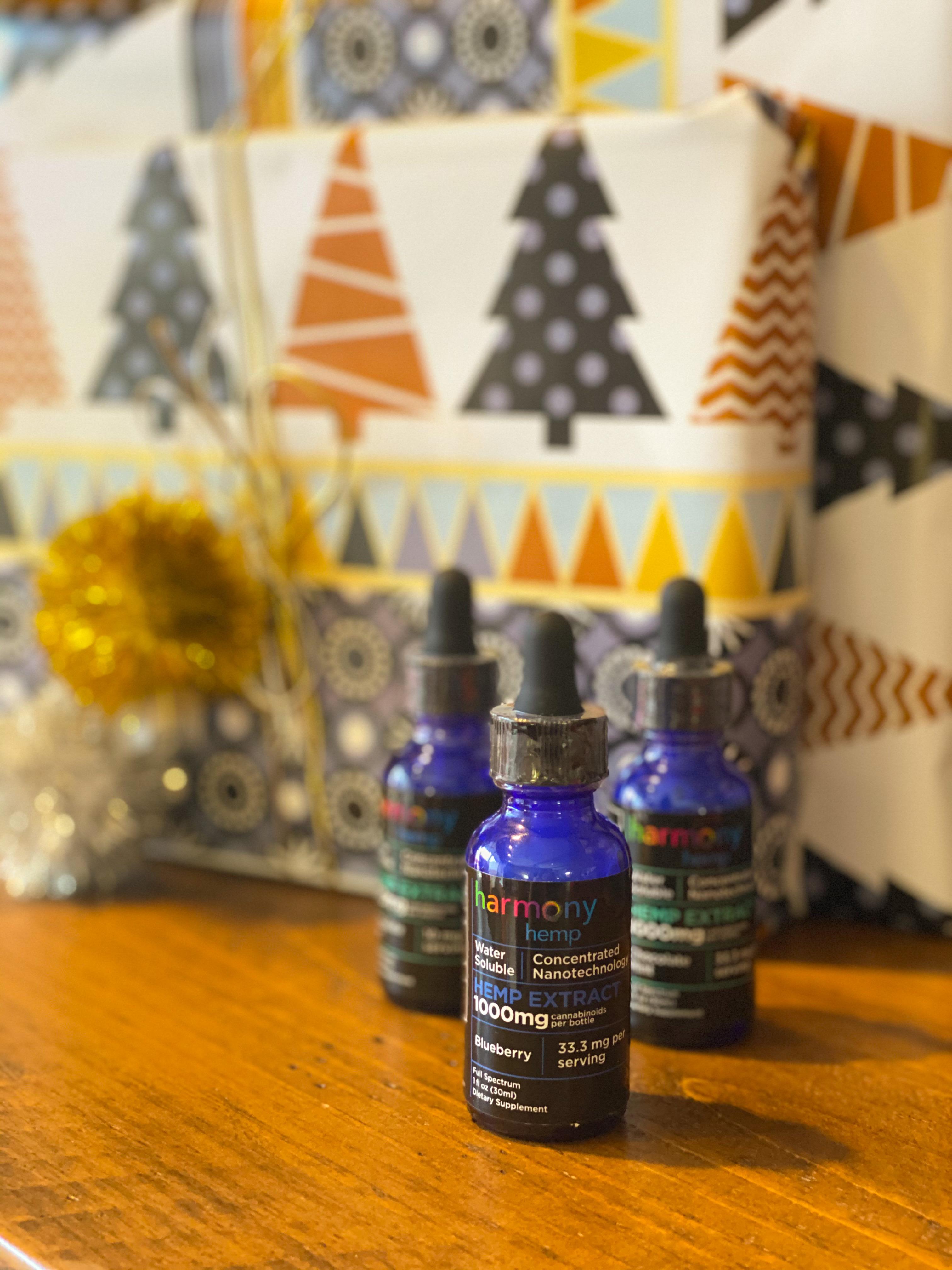 bottles of cbd oil flavors on wood table