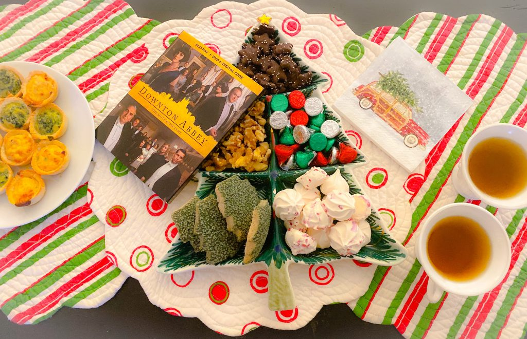 holiday movie snacks spread on red and green placemats