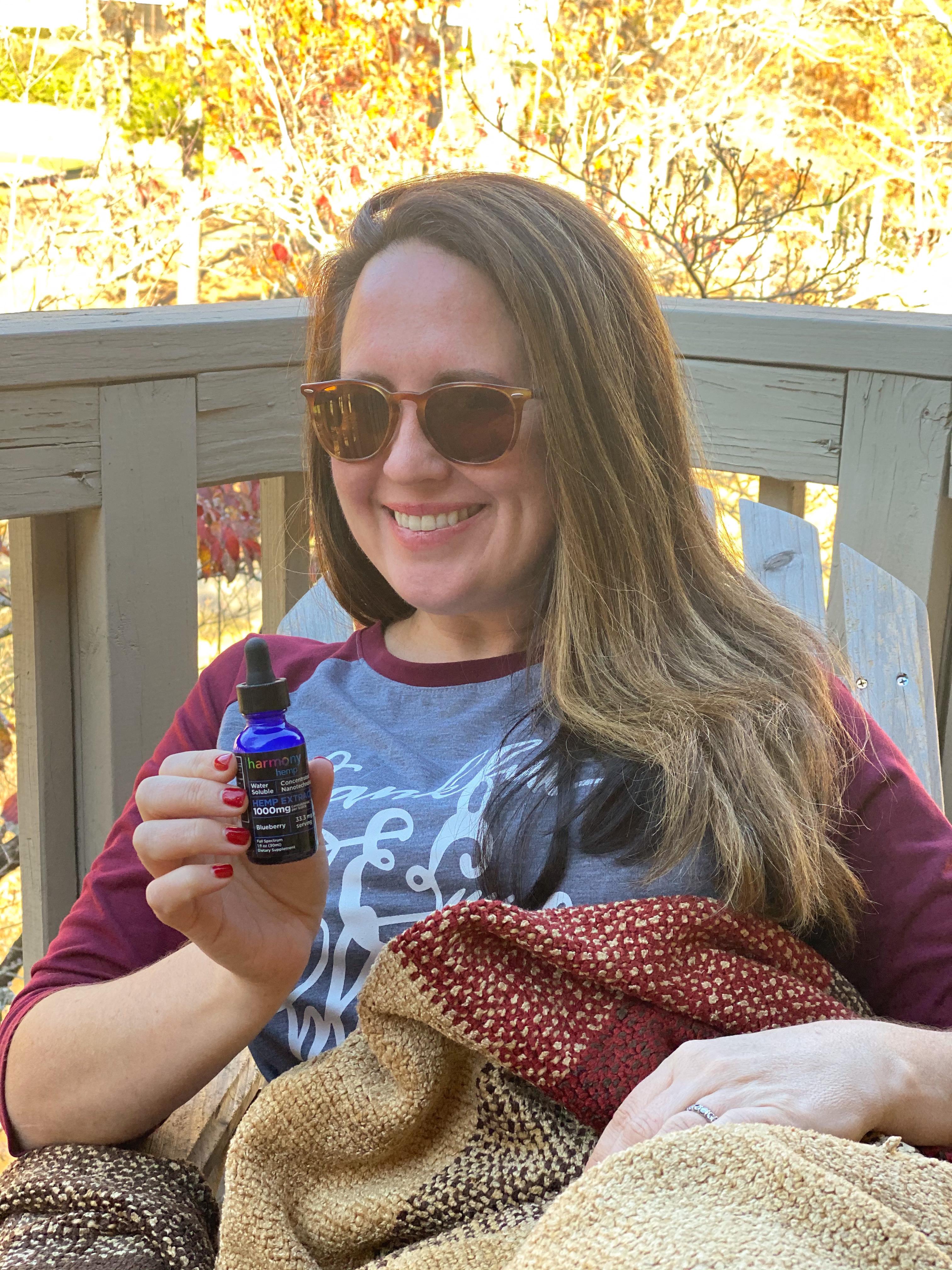 woman holding cbd oil bottle