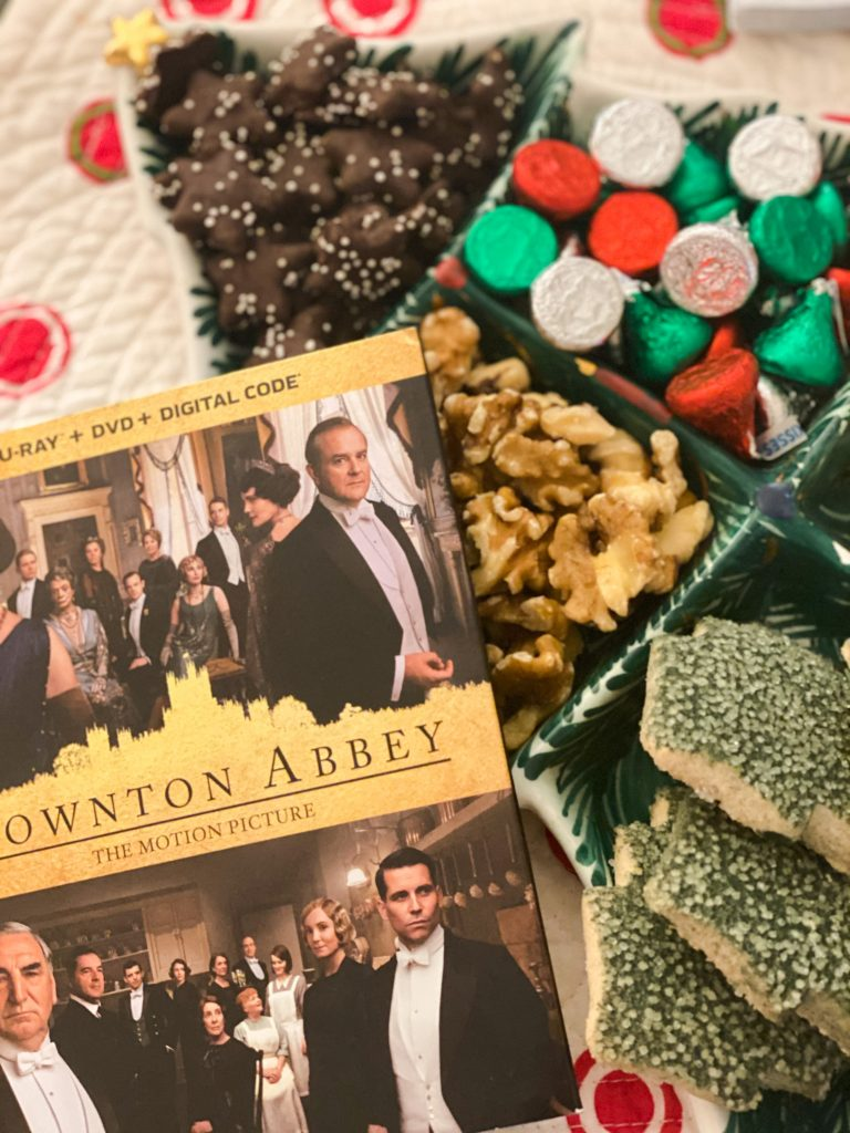 downtown abbey dvd next to holiday snacks