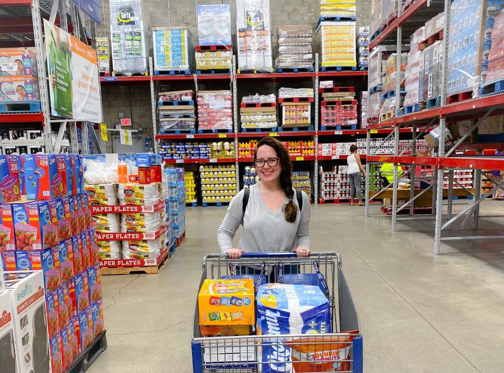 woman pushing shopping cart through Sam's Club